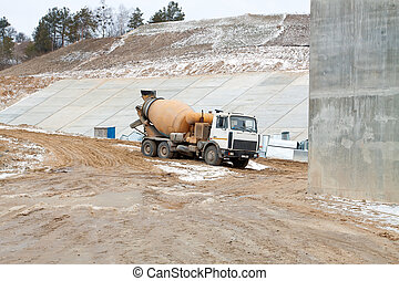Truck operator pouring cement - Car mixer shown in the...