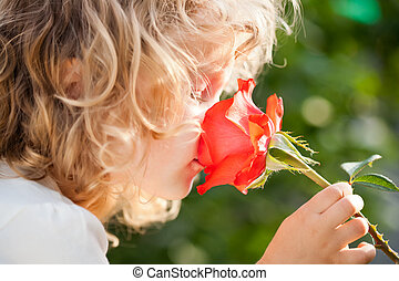 Child with flower - Child with rose flower in spring garden
