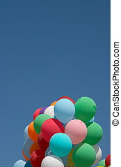 Countless colorful balloons flying in deep blue sky