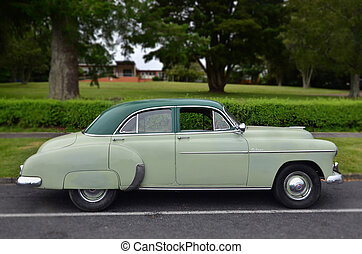 Old Classic and Vintage Cars - An old green vintage car in...
