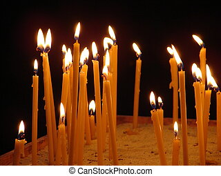 Mass of flaming candles upon black background