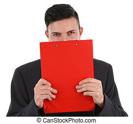 Business guy behind clipboard - A business guy hiding behind...