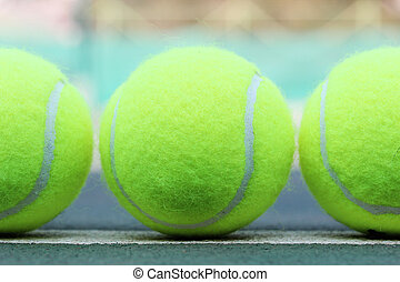 Brand new tennis balls arranged in a row - Photo of brand...