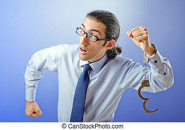 Businessman with handcuffs running away