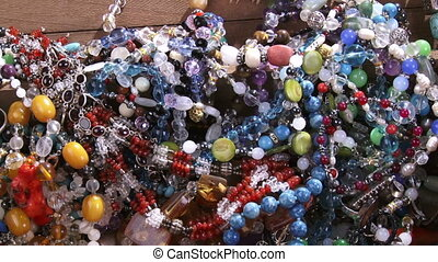 Jewelry, pan left, gems, crystals, silver...