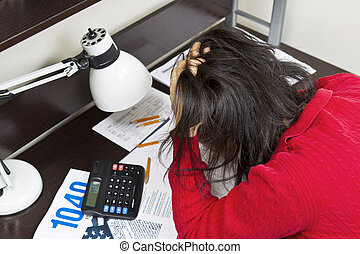 Tax Nightmare - Asian woman displaying anger with tax forms,...