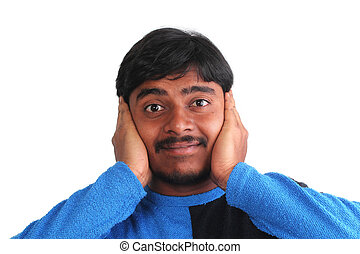 Indian male showing distress by covering his ears