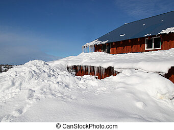 House buried in snow - House buried in deep snow with a...
