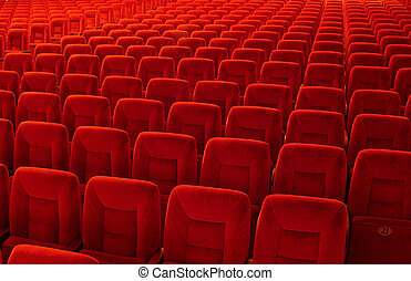 abstract background of countless red seats of theater hall