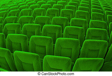 abstract background of countless green seats of theater hall