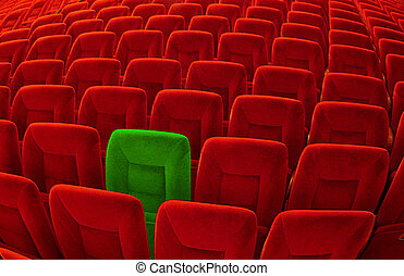 One green chair among background of countless red seatings