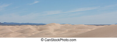 Desert Dunes panorama - Sand dunes rippling across the...