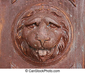 vintage ancient wooden doorhandle lion head decoration