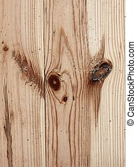 supernatural bizarre alien face of knots on textured wood plank