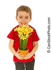 Happy boy offering flowers