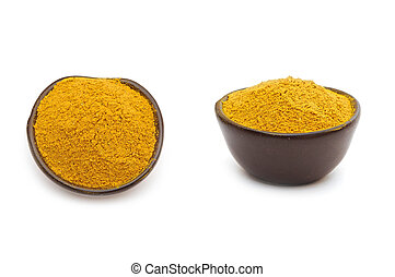 Curry spices in a clay bowl