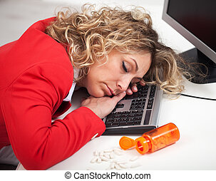 Asleep at the office - woman sleeping despite energy pills