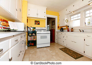 White and yellow old simple kitchen. - White old small...