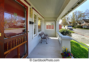 Old house porch with street spring view.