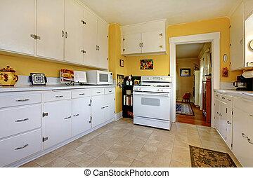 Old white English kitchen interior. - Cozy simple white...