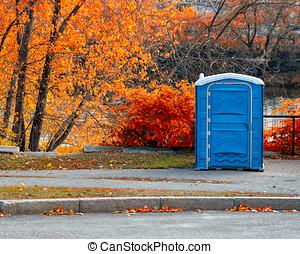 Plastic Outhouse Autumn landscape - Blue plastic outhouse...