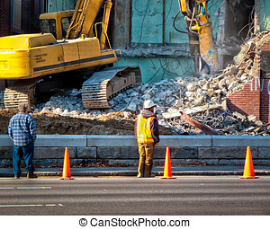 Hydraulic Excavator Urban Renewal - Construction workers...