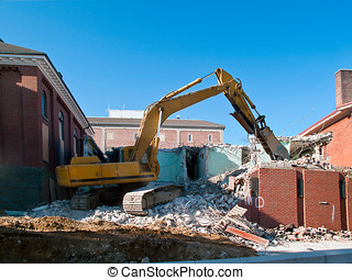 Hydraulic Excavator works hard to take down a city building...