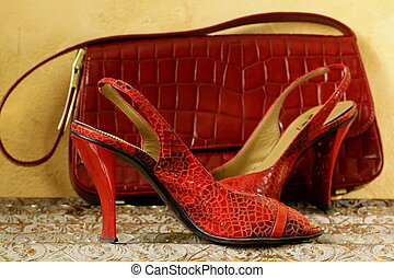 Fashion stylish red womens shoes at the glamorous background...