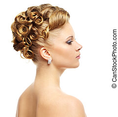 Girl with modern hairstyle isolated on a white