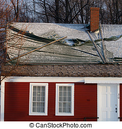 Red house roof damage - Light snow and platic tarps cover...