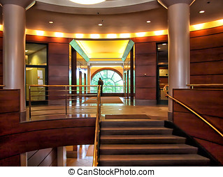 Art Deco Building Lobby - Man standing in brass and glass...