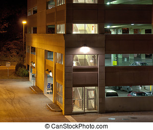 Parking Garage At Night - Urban car parking garage at night...