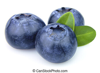 Blueberry closeup - Blueberry with leafs close up on a white...