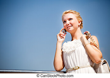 Beautiful woman talking over phone