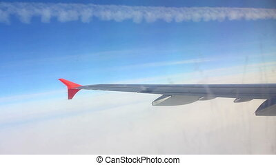 looking on wing and sky from airplane