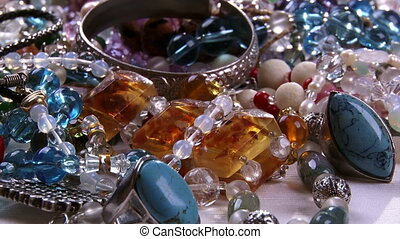 Jewelry, camera dolly, closeup, gems, crystal, silver