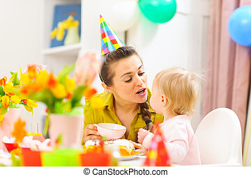 Mother celebrating first birthday of her baby