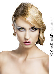 blond vintage girl portrait, she si in front of the camera