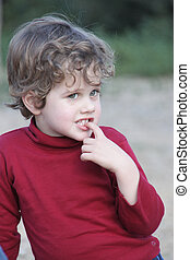 Boy in a Red Waistcoat - Blond boy with curly hair wearing a...