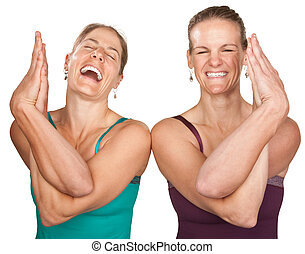 Happy Yoga Women - Two laughing women performing entwined...