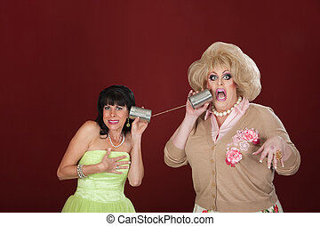 Women With Tin Can Telephones - Retro-styled woman with drag...