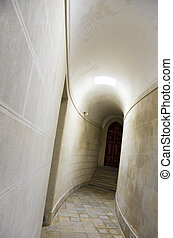 White corridor - Long corridor with white walls and brown...