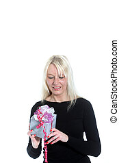 Pretty woman with a wrapped gift