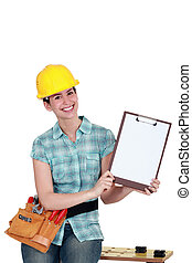 Tradeswoman holding a blank clipboard