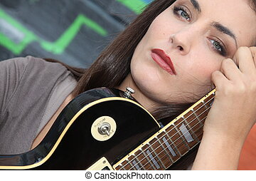 Brunette with electric guitar