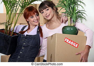 Girls roommates moving into their new apartment