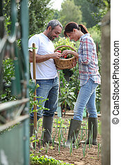 Couple in a garden with boots