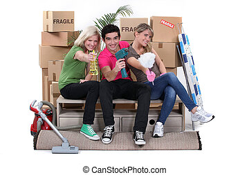 Young people moving into a new home