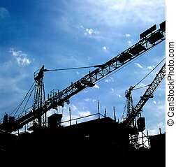 crane silhouette 02 - Silhouette of some construction cranes...