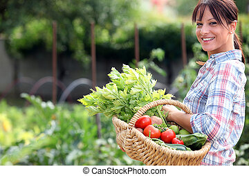 Woman in her vegetable garden